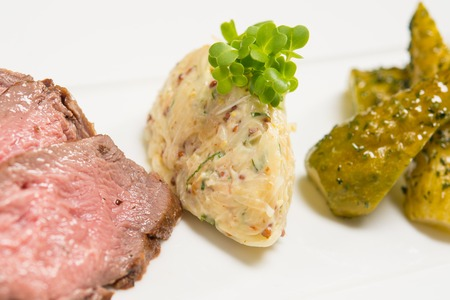 Slices of meat with marinated cucumbers Stock Photo - 22365495