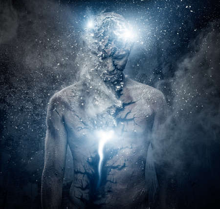 Man with conceptual spiritual body art photo