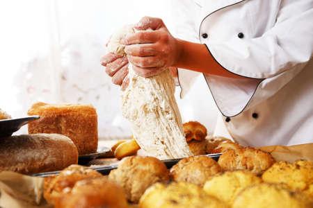 baker: Cook hands preparing dough for homemade pastry