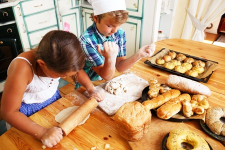 Happy children cooking homemade pastry photo