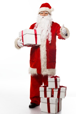 Santa Claus with gift boxes isolated on white background  photo
