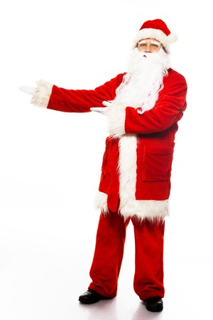 Santa Claus showing with gestures something isolated on white  photo