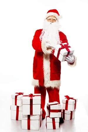 Santa Claus with gift boxes isolated on white  photo