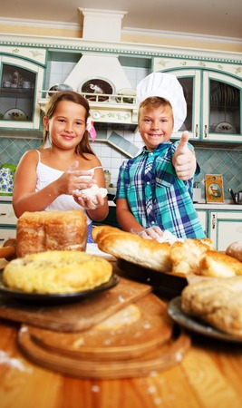 lear: Happy children cooking homemade pastry