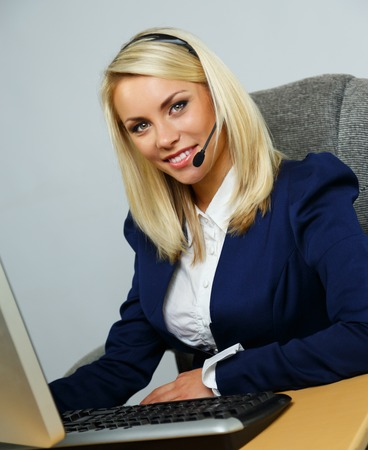 Beautiful blond help desk office support woman with headset Stock Photo - 23487786