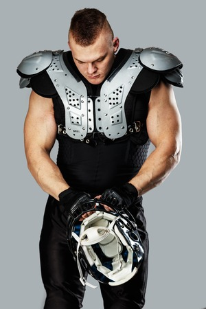 quarterback: American football player with helmet and armour