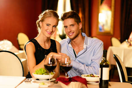 Young beautiful couple in love in a luxury restaurant photo