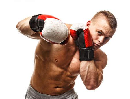 boxeador: Apuesto joven musculoso con guantes de boxeo