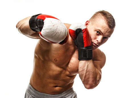 male boxer: Handsome muscular young man wearing boxing gloves