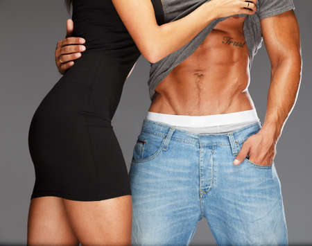sexy man: Young woman embracing man with muscular torso