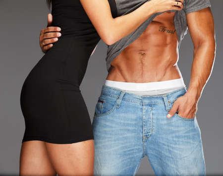 men body: Young woman embracing man with muscular torso