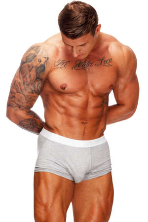 Man with beautiful muscular tattooed torso in underwear  photo
