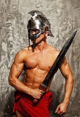 helmets: Gladiator with muscular body with sword and helmet