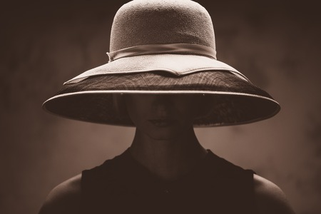 are hidden: Young woman in big hat