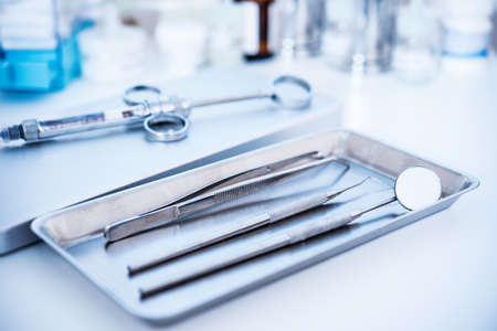 handle with care: Dental tools and syringe at dentists surgery  Stock Photo