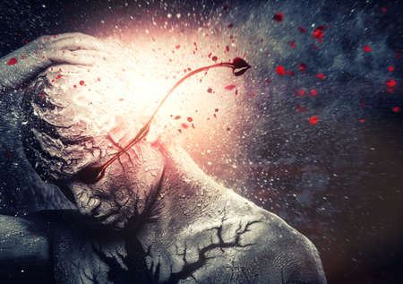 mind body soul: Man with conceptual spiritual body art and bloody tears Stock Photo