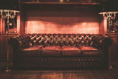 red sofa: Leather sofa in vintage style luxury interior  Stock Photo