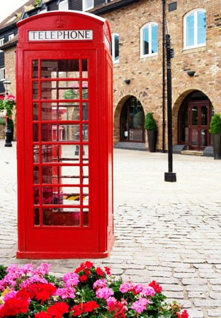 telephone box: Traditional british red phone booth  Stock Photo