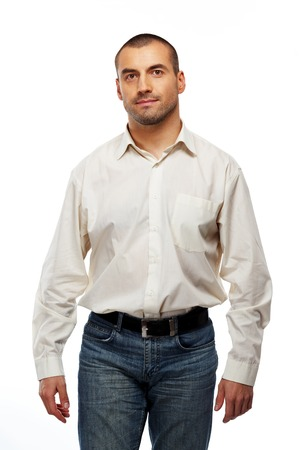 Handsome man in white shirt walking on white background photo