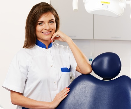 Young beautiful brunette woman dentist at dentists surgery  photo