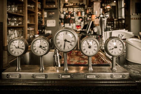bar counter: Vintage clocks on a bar counter in a pub