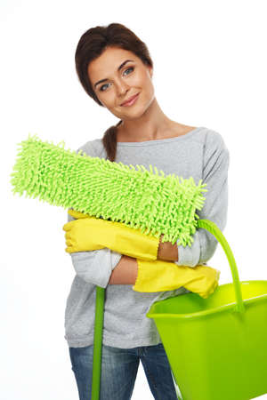 charlady: Beautiful cheerful brunette woman in gloves with mop and bucket