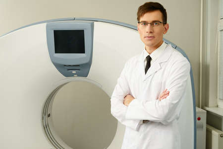 computed: Young doctor standing near computed tomography scanner in a hospital Stock Photo