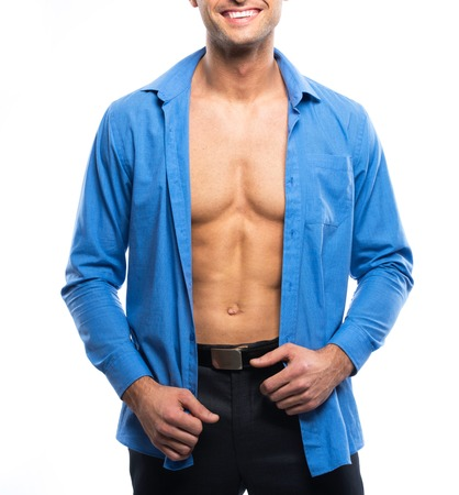 to undress: Handsome sexy man in blue shirt and black pants Stock Photo