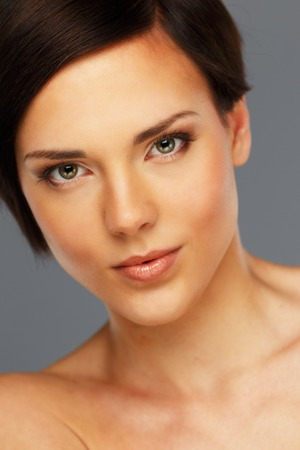 short haircut: Beautiful young woman with short haircut