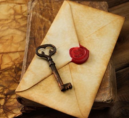 vintage envelope: Book, old key and envelope on vintage blank paper