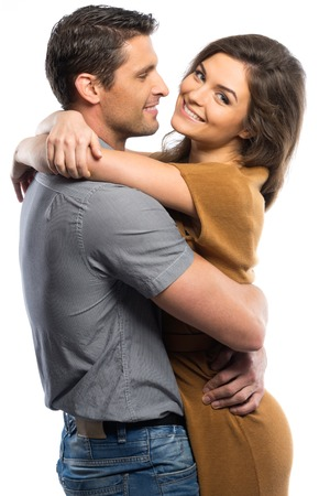 hugging couple: Happy couple in shirt and dress hugging isolated on white