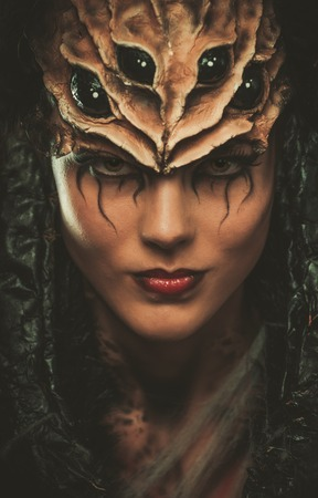 witch spider: Young woman with spider body art and mask