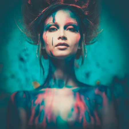 human aura: Young woman muse with creative body art and hairdo