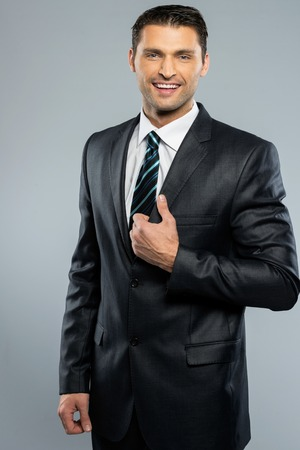 Well-dressed handsome man in black suit and tie  photo