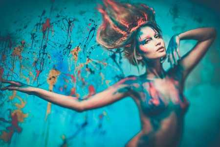 alien women: Young woman muse with creative body art and hairdo