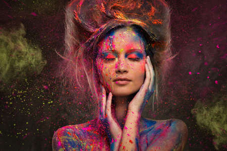 aura: Young woman muse with creative body art and hairdo
