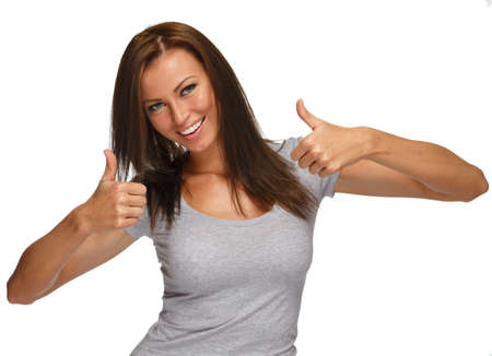 Young positive brunette girl with long hair  showing thumbs up