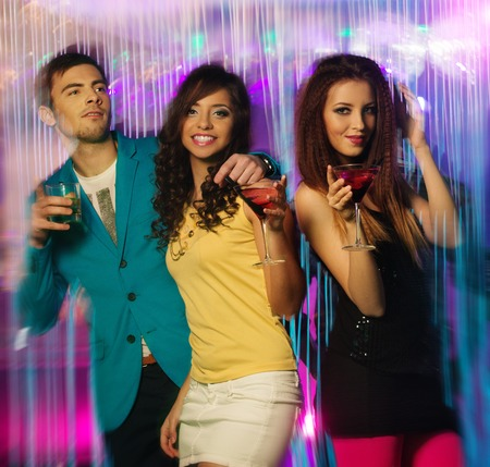 dancing club: Group of happy young people dancing at night club  Stock Photo