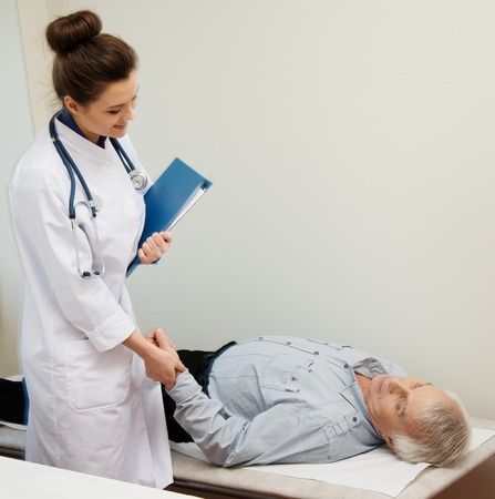 daybed: Senior man lying at daybed at doctors office Stock Photo