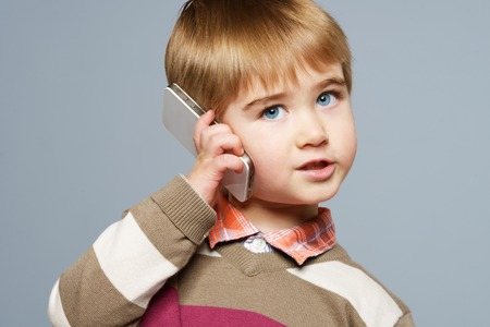 Little boy with mobile phone  photo