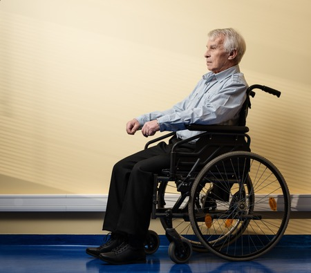 man in chair: Thoughtful senior man in wheelchair in nursing home  Stock Photo