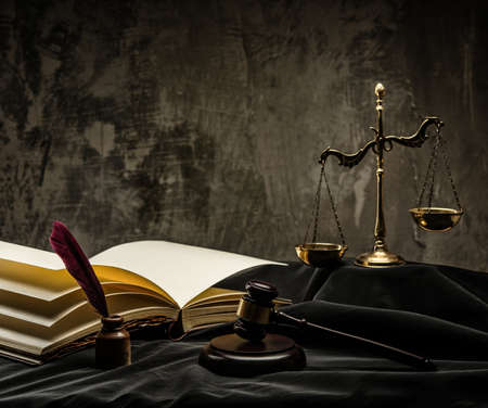 criminal case: Scales and wooden hammer on judges mantle  Stock Photo