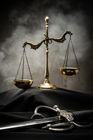 Scales and sword of Justice on a judges mantle Stock Photo