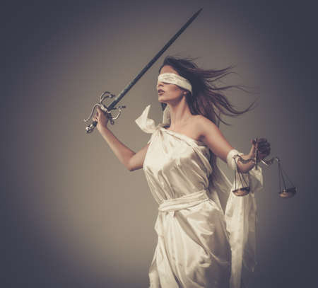 lady justice: Femida, Goddess of Justice, with scales and sword wearing blindfold