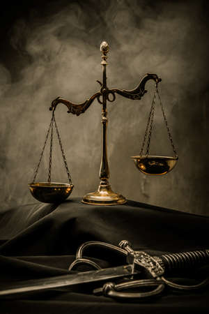 Scales and Sword of Justice on a judges mantle photo