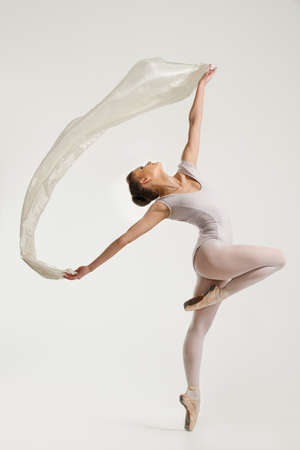 ballerina costume: Young ballerina dancing with piece of silk fabric  Stock Photo