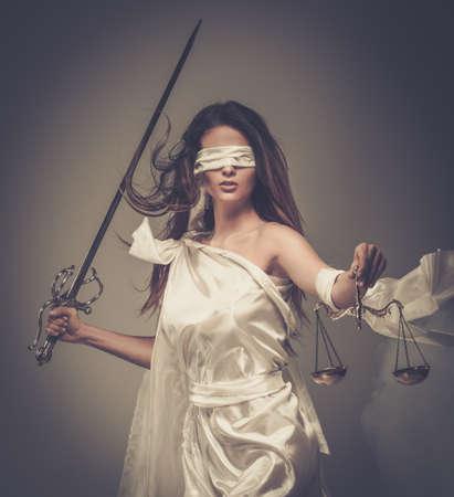 femida: Femida, Goddess of Justice, with scales and sword wearing blindfold