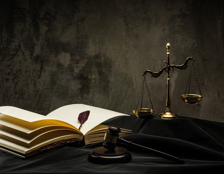 verdicts: Scales and wooden hammer on judges mantle  Stock Photo