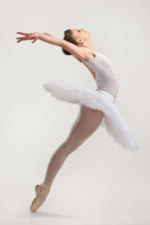 ballet dancing: Young ballerina dancer in tutu performing on pointes
