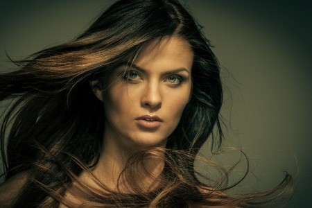 Seductive fatal brunette woman with long hair  photo